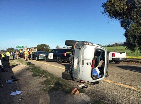 A rolled car brought traffic to a crawl Tuesday morning south of Storke Road on northbound Highway 101.
