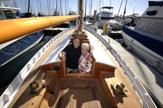 <strong>SEAWORTHY:</strong> Ken and Loretta Minor stand aboard Morning Song, which they spent the last 25 years building.