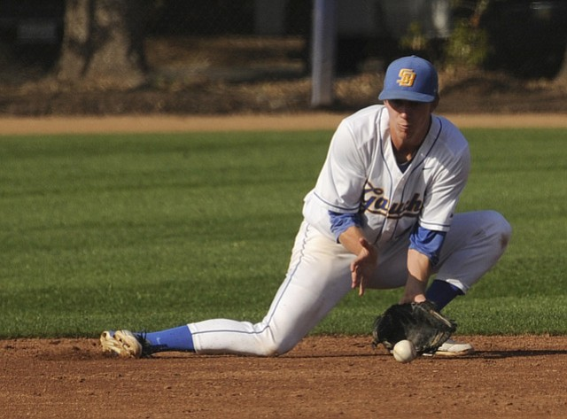 "<strong>COMING UP TALL: </strong>UCSB's sure-handed Clay Fisher scoops up a grounder. Coach Andrew Checketts calls him ""the best defensive shortstop I've ever seen."""