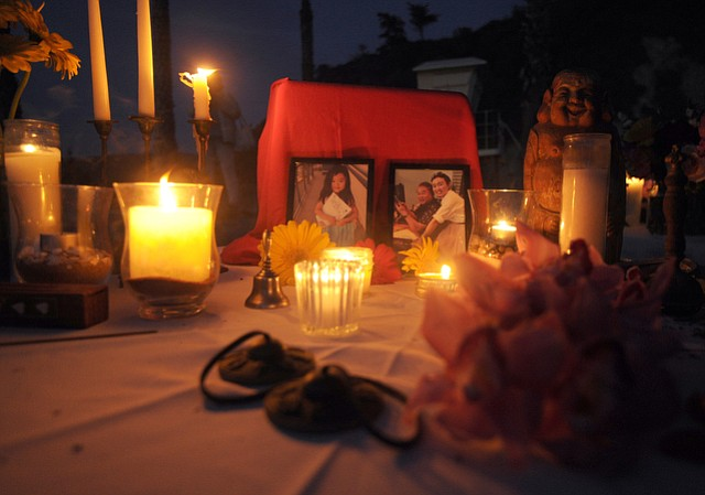 """Some 200 Han family friends and Santa Barbara Herb Clinic patients gathered Sunday at Hendry's Beach to remember Dr. Weidong """"Henry"""" Han, Jennie Yu, and Emily Han."""