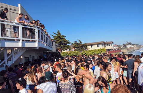 <strong>PARTY ON: </strong> Crowds packed balconies and porches during this year's Deltopia.