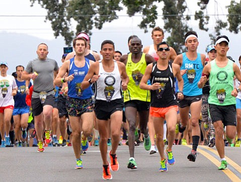 "<strong>STRATEGIZED STEPS:</strong>  Last year's winner Ramiro ""Curly"" Guillen (above in white) released his beast within to win the Wine Country Half Marathon."