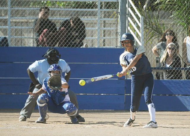 "<strong>DIAMOND SMASHING:</strong> Dos Pueblos High's Madison Pickett connects on one of her three hits against San Marcos last Friday. Pickett, bound for MIT, says softball helps her ""relax my brain."""