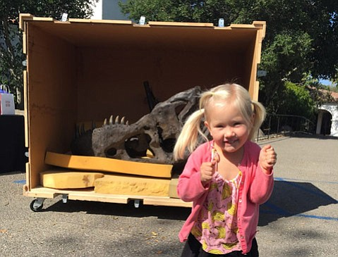 """The author's daughter,  Isida Gruzdeva, poses with the """"T. Rex Named Sue."""""""