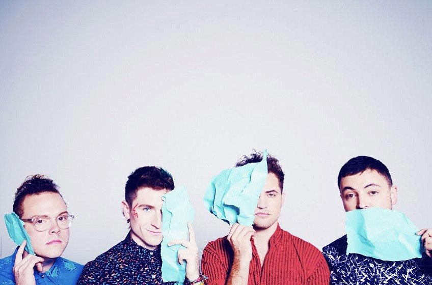 "<strong>RALLYING CALL:</strong> Walk the Moon's Eli Maiman (far right) said their anthemic music is meant as ""a battle cry ... for community and for groups of people."""