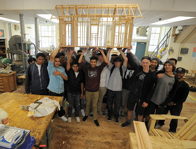 <b>NOT ACTUAL SIZE: </b> SBHS shop class with their Tiny Home model.