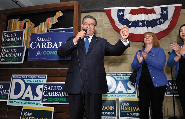 TOP DOG:  Salud Carbajal, who snagged first place in the 24th Congressional District race, celebrates at Benchmark Eatery.