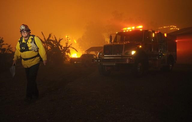 Firefighters work the Scherpa Fire on La Paloma Ranch. (June 15, 2016)