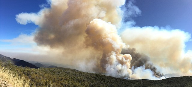 Ray Ford, standing on West Camino Cielo, reported Thursday afternoon that two large flame columns were headed toward the top of the mountains before the winds shifted and they started moving east