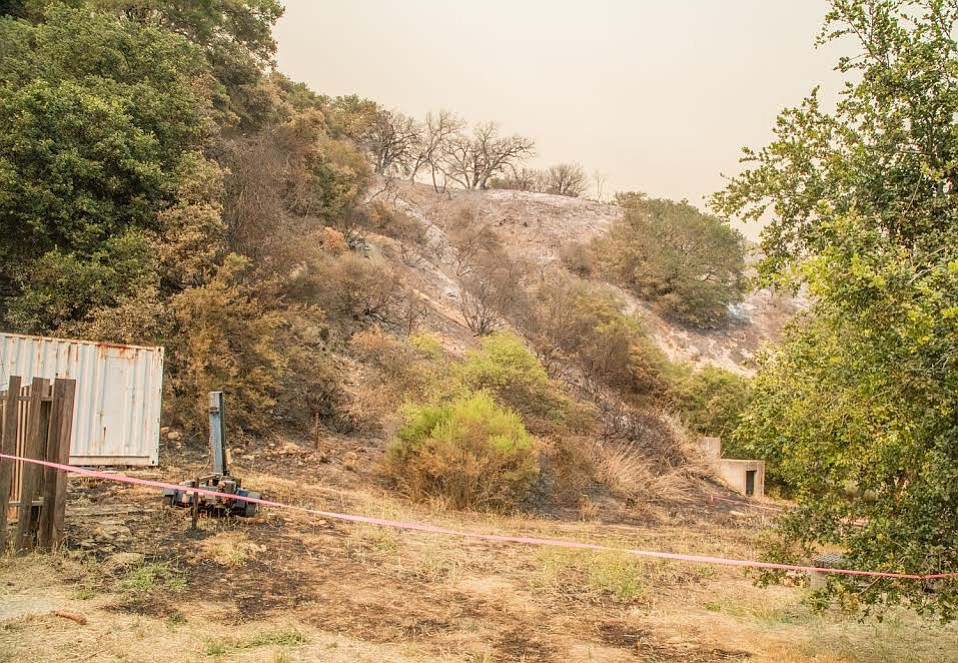Authorities believe the fire started when sparks or fuel from a small wood splitter ignited grass in a vacant lot of Rancho La Scherpa.
