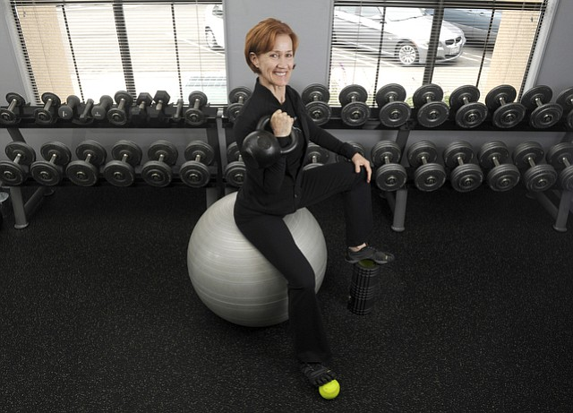Mikki Reily of Fitness Transform utilizes kettle bells, foam rollers, and stability balls as part of her workout program
