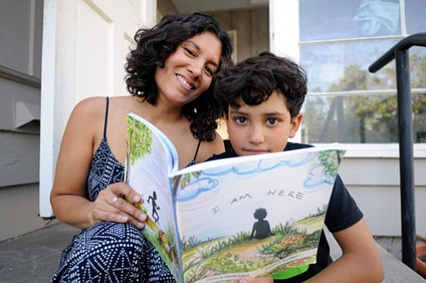 Lynette Gaona with her son Cainan and her book I Am Here
