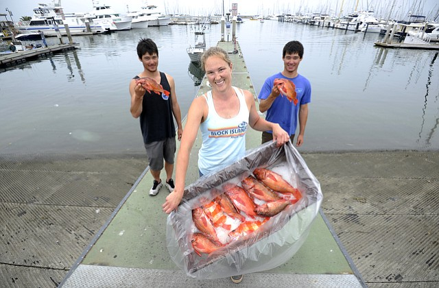 Sarah Rathbone holds a box of vermilion and flag rockfish flanked by fishermen Shen (left) and Waiman Meinhold with a catch (June 28, 2016)