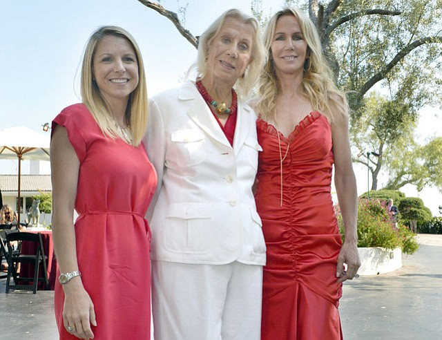 Guest of honor Betty Stephens (center) with her daughter Joi Stephens (right) and executive director Lisa Dosch (left)