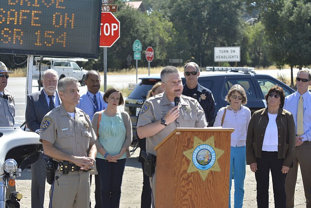 "CHP Lt. Kurt Kruse (center) cited an ""influx"" of accidents on the 154 as the cause for increased attention by law enforcement officials."