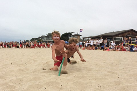 <b>SAND SHARKS:</b> Junior guards race for the flag as a shark sighting shuts down water comps.