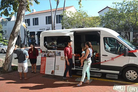 Santa Barbara Street Medicine volunteers discuss their new mobile unit with passersby on State Street.