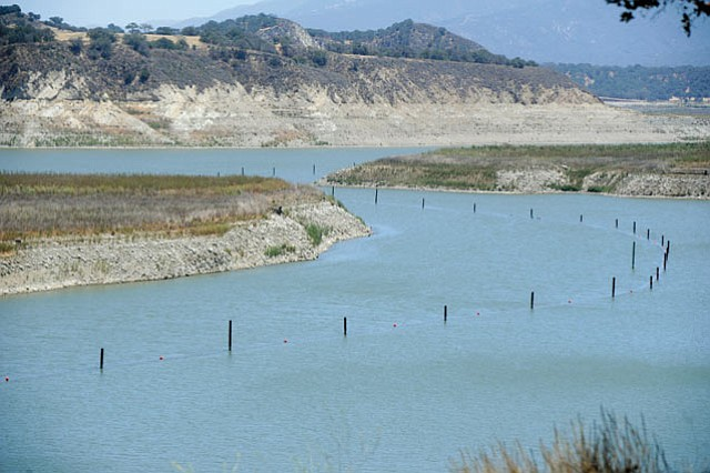 """<b>WATER TORTURE: </b> With Lake Cachuma lower than it's ever been, tensions between the water agencies relying on it have hit the breaking point. Adding to the pressure, S.B. city officials announced the start-up date for the desalination plant could be pushed back by as much as two months, coupled with cost overruns approximating $8 million. The culprits are contaminated soil—12,700 cubic yards' worth—and ancient electrical equipment that """"exploded"""" upon testing."""