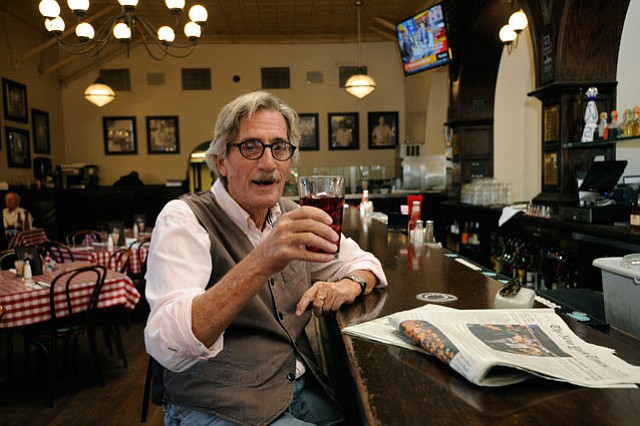 <b>EXPLORING INEBRIATION:</b> It's common to find Ralph Lowe (above) sipping on red wine with ice at Joe's Café on State Street.