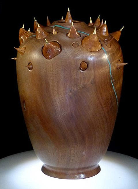 <strong>POT WITH POINTS:</strong> This black walnut pot featuring ornamental silk floss thorns is one of the works by Robert C. Perry included in Views from the North at the Arts Fund.