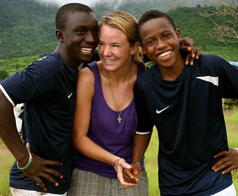 <b>DUNN TO AFRICA AND BACK:</b> Dunn School alum Kelsey Sullivan (center) is hosting 14 students/