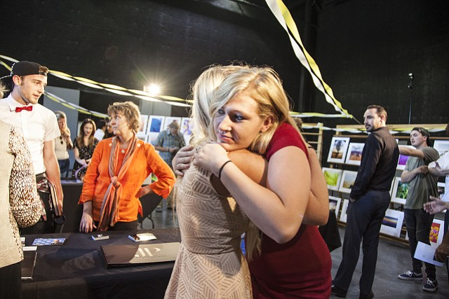 <b>SO LONG:</b> Kayse Crandall (left) and Torrey L. Thomas hug during the last portfolio show at Brooks Institute.