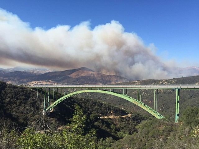 A 100-acre brush fire is burning off Paradise Road near the White Rock Campground.