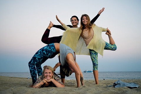 <b>TWISTED ACTIVISM:</b> From left, Yogi Movement's cofounders Marta Waldrop Bergman and Isa Oestman Olai (in backbend) pose with social media coordinator Camilla Yahyaoui and public relations officer Linda Sturesson.