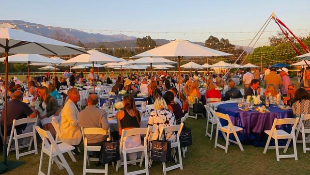 Guests enjoy Mediterranean buffet al fresco.