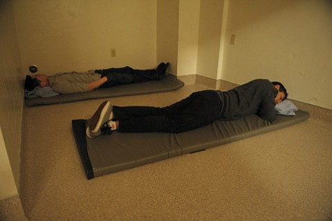 <b>IN FOR THE NIGHT: </b> Two guests of Santa Barbara's sobering center sleep it off.