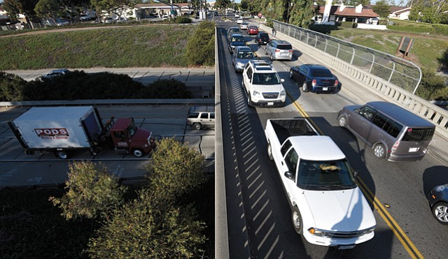 <b>CHOKED, SMOKED, AND CROAKED: </b> The Casitas Pass freeway bridge strains under the intense demand of early-morning rush hour.