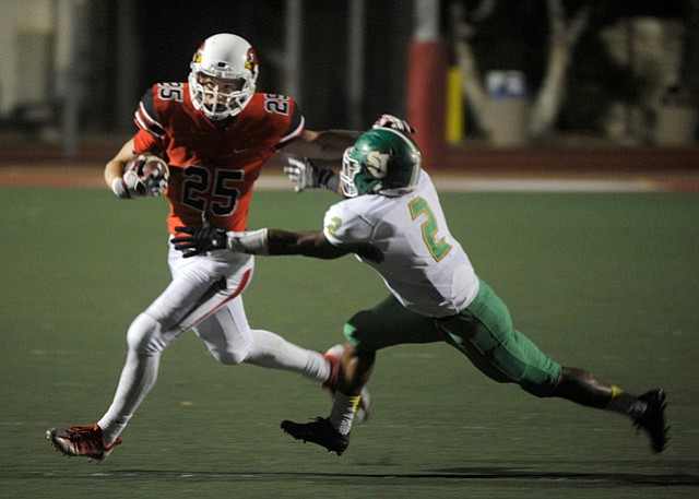 <b>FULL-MOON WORKHORSE:</b>  Bishop Diego High's John Harris (25) ran for 204 yards on 25 carries against St. Joseph, as the Cardinals and Knights played their Friday-night football game under a full moon (below).