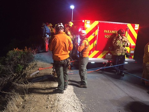 Rescue personnel respond to the second crash off Gibraltar Road.