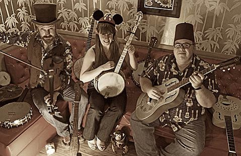 <strong>GOOD OLD TIKI TIME:</strong>  David Bragger's band Sausage Grinder, which plays at the Old Time Fiddlers' Convention & Festival, relaxes in Bragger's Old-Time Tiki Parlour.