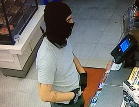Surveillance footage of the 7-Eleven robbery matched the suspect's tattoos to Alward's