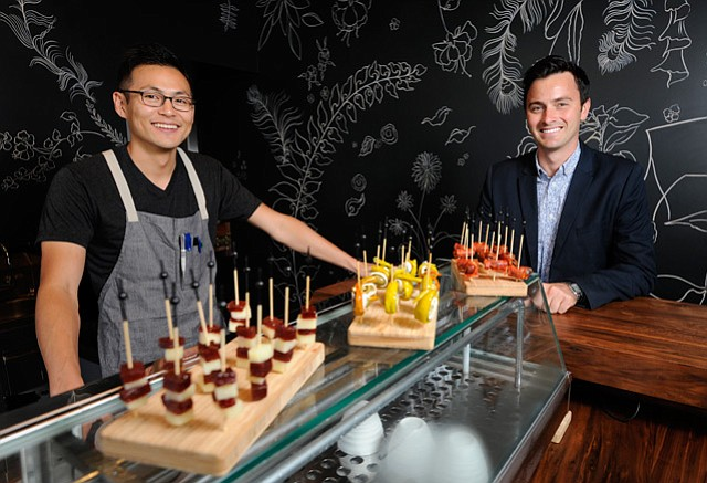 <b>SPAIN VIA S.B.:</b>  Loquita's executive chef Peter Lee (left) and GM Skylar Gamble bring tapas, pintxos, and paella to lower State Street.
