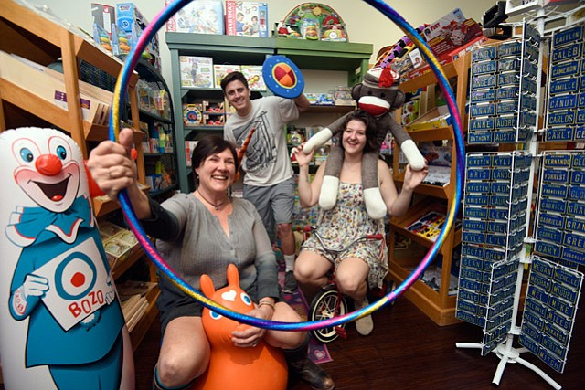 <b>ALL-AGES FUN:</b> Pictured from left, Lisa Gerr, Zac Colegrove, and Emily Gerr encourage shoppers to touch everything on their shelves.