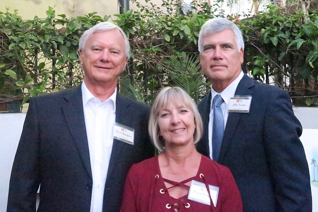 Board president David Gustafson, his wife Nancy Gustafson, and executive director John Fowler.