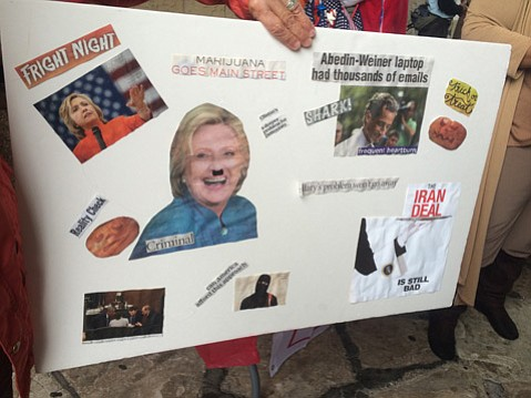One Trump demonstrator held a sign that depicted Hillary Clinton as Adolf Hitler