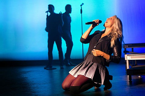 "<strong>SINGING STAR:</strong>  Amy Whitcomb, who was on two seasons of <em>The Sing-Off</em>, is featured prominently on many songs. ""When you have someone that good at singing harmony and vocals, it's basically a home run,"" director Deke Sharon said."