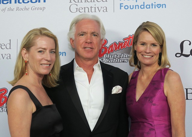 Board chair Kenny Slaught with his wife, Elizabeth Slaught (left) and CEO Kisa Heyer (right).