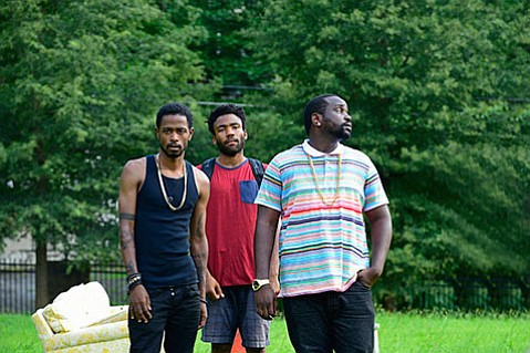 <strong>IN EARNEST:</strong> Donald Glover (center) plays a Princeton dropout aiming for stardom in his new half-hour dramedy, <em>Atlanta.</em>