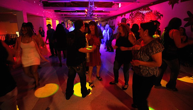 <b>GETTIN' DOWN: </b> Dancers boogie to the Anthony Prieto Band at La Casa de la Raza's 45th anniversary celebration.
