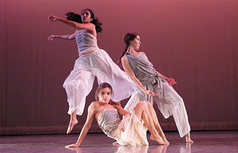 <strong>LEAPS AND BOUNDS:</strong> Pictured from left, dancers Moira Saxena, Jenna Wilson, and Samantha Gerraty perform in <em>Double Exposure: Revealing | Relating | Responding</em>.