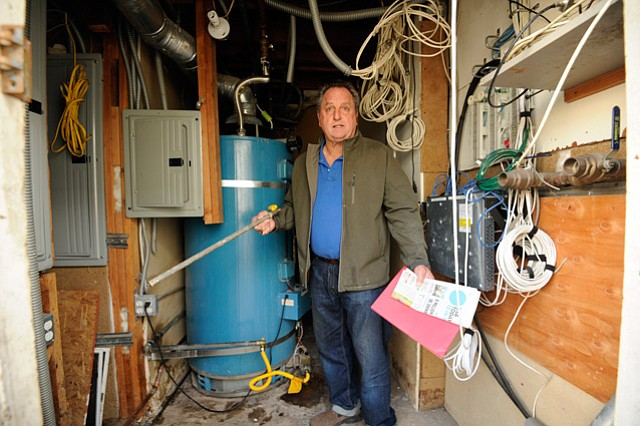 <b>PILING ON: </b>Dario Pini claims city inspectors are looking for any pretext to shut him down. Here he shows a water-heater pipe — one-quarter inch in diameter too small, according to city building codes — that got his Alamar hotel closed. Pini said it took only half an hour to make the fix.