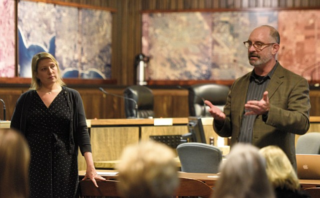 <b>RALLYING THE TROOPS: </b> Emily Allen (left) and Chuck Flacks (right) brief volunteers with this year's Point in Time index, which documents the number of homeless people living in Santa Barbara County.