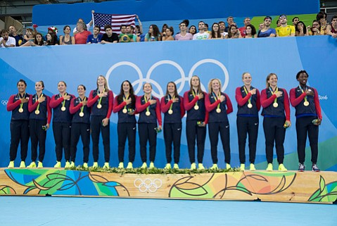 <b>OLYMPIC BLING:</b> The U.S. women's water polo team wears gold during the awards ceremony at the Rio Olympics. It includes Santa Barbara players Kami Craig (second from right), Kiley Neushul (sixth from right), and Sami Hill (far left).