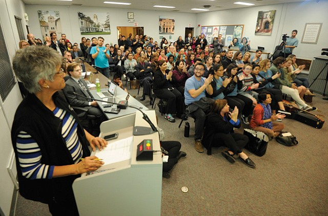 <b>HEAR, HEAR! </b> Loud applause greeted the reading of the school district's safe campus resolution.