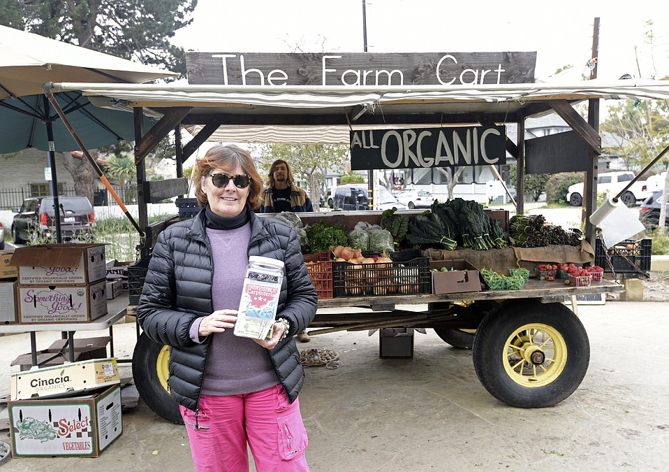 Leslie Westbrook, cofounder of Indivisible Carpinteria, discusses a new food drive program at the Farm Cart