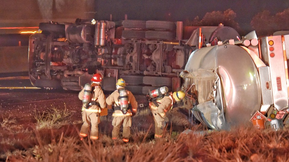 The overturned semi-tanker spilled more than 5,000 gallons of gasoline onto the roadway, disintegrating the concrete
